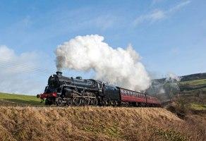 75078 looks impressive as she passes the 'Mound' below Oakworth - Robin Lush