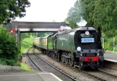Carrying a headboard that commemorated the maiden voyage of the SS Canberra, pulls into Winchcombe.