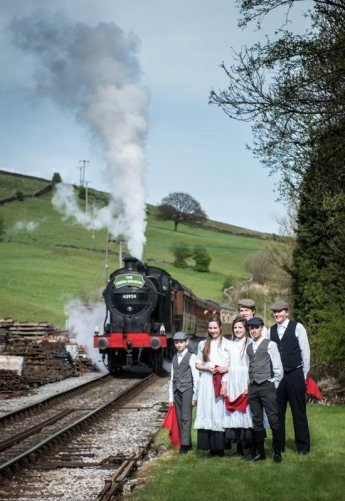 The cast of the re-enactment with the 'Green Dragon' waiting to enter Oakworth.