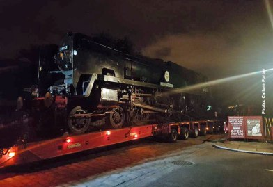 Night has fallen as 34053 arrives at Ingrow.