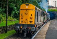 ... D0226 on the front and 20 031 at the rear depart for Haworth.